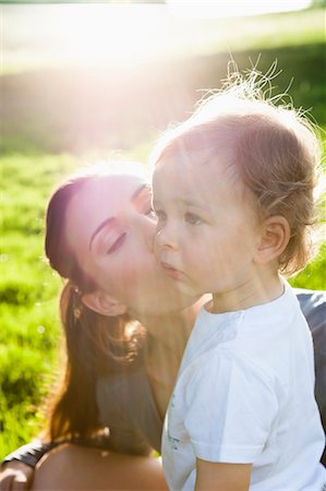 Mother kissing toddler in park Stock Photo - Premium Royalty-Free, Code: 649-05800959