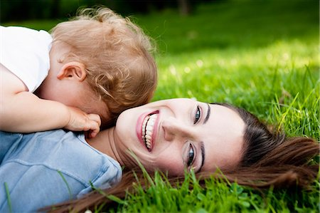 shy baby - Mother holding toddler in park Stock Photo - Premium Royalty-Free, Code: 649-05800965