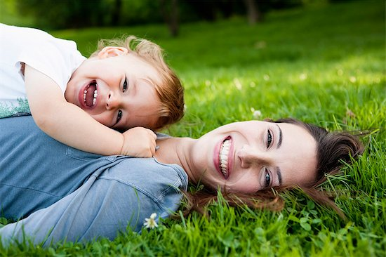 Mother holding toddler in park Stock Photo - Premium Royalty-Free, Image code: 649-05800966
