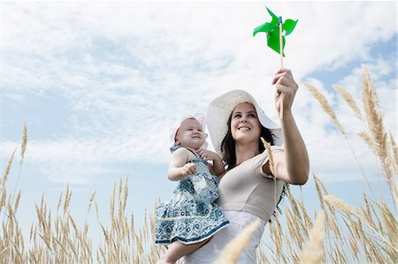 Woman holding pinwheel for daughter Stock Photo - Premium Royalty-Free, Code: 649-05801231