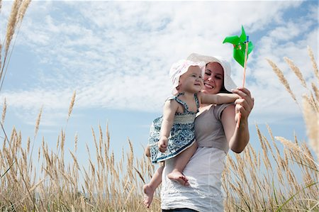 Woman holding pinwheel for daughter Stock Photo - Premium Royalty-Free, Code: 649-05801232