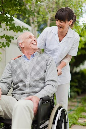 Nurse wheeling older patient outdoors Stock Photo - Premium Royalty-Free, Code: 649-05801277