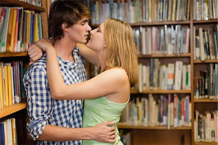 Students kissing in library Stock Photo - Premium Royalty-Free, Code: 649-05801362