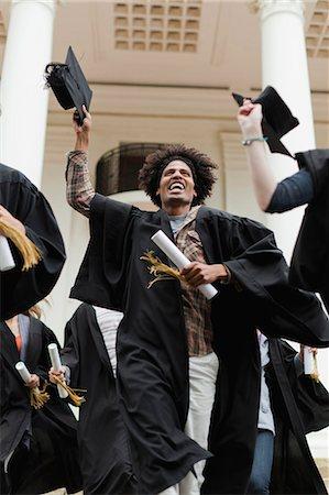 Graduates cheering on campus Stock Photo - Premium Royalty-Free, Code: 649-05801415