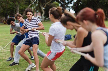 Friends playing tug of war in park Stock Photo - Premium Royalty-Free, Code: 649-05801425