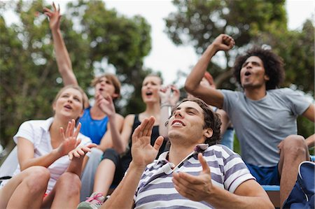 Friends cheering at sporting event Stock Photo - Premium Royalty-Free, Code: 649-05801427
