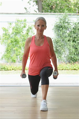Older woman exercising at home Stock Photo - Premium Royalty-Free, Code: 649-05801587