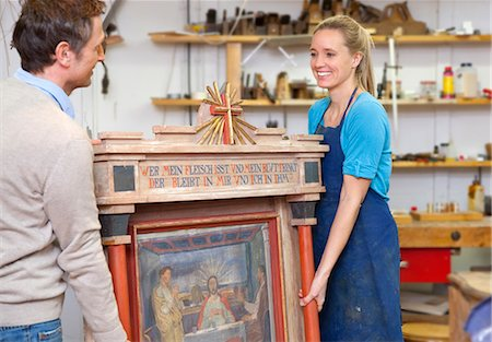 Carpenters carrying antique art piece Stock Photo - Premium Royalty-Free, Code: 649-05801751
