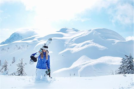 sports and snowboarding - Man carrying snowboard in snow Stock Photo - Premium Royalty-Free, Code: 649-05801872