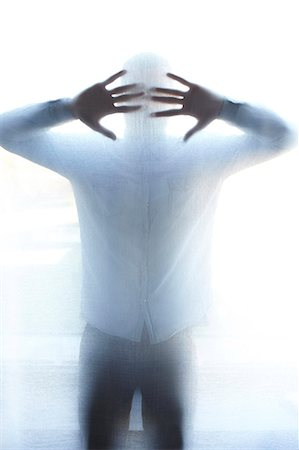 Man standing behind thin screen Stock Photo - Premium Royalty-Free, Code: 649-05801914
