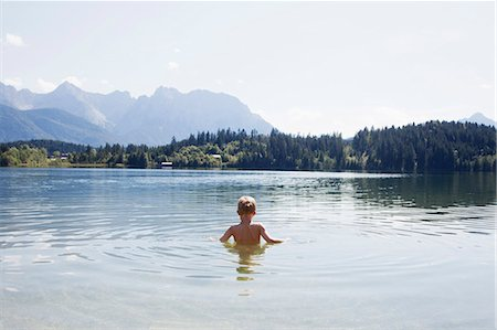 discovery - Boy swimming in lake Stock Photo - Premium Royalty-Free, Code: 649-05802119