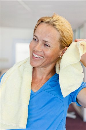 fitness   mature woman - Woman toweling off in gym Stock Photo - Premium Royalty-Free, Code: 649-05802158