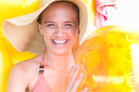 preteen beauty - Teenage girl in braces wearing sunhat Stock Photo - Premium Royalty-Free, Code: 649-05819676