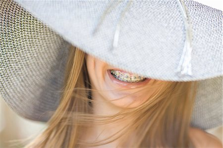 preteen beauty - Smiling girl in braces wearing sunhat Stock Photo - Premium Royalty-Free, Code: 649-05819673