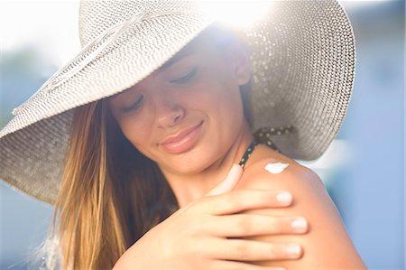 preteen touch - Teenage girl applying sunscreen outdoors Stock Photo - Premium Royalty-Free, Code: 649-05819697