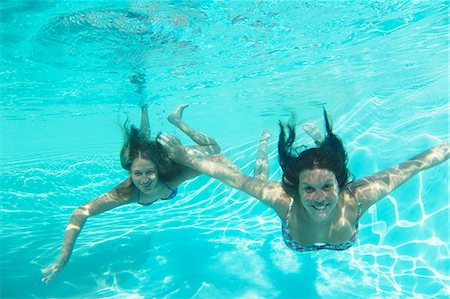 Mother and daughter swimming in pool Stock Photo - Premium Royalty-Free, Code: 649-05819757