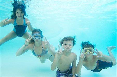 Smiling children playing in pool Stock Photo - Premium Royalty-Free, Code: 649-05819751