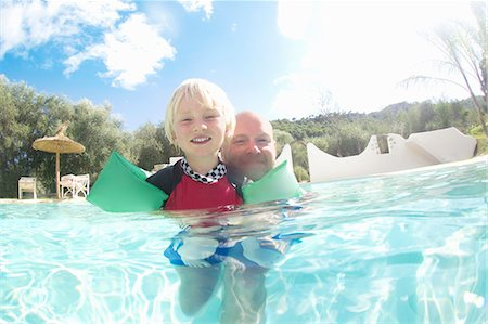 Father and son playing in pool Stock Photo - Premium Royalty-Free, Code: 649-05819767