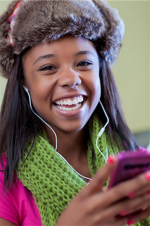 Teenage girl listening to headphones Stock Photo - Premium Royalty-Free, Code: 649-05819945