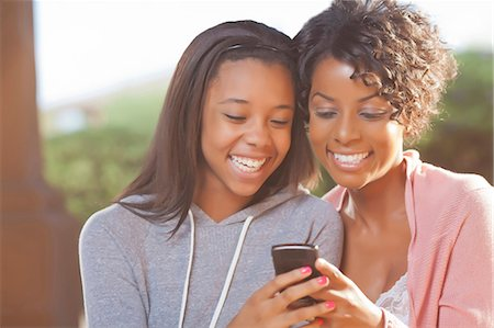 Mother and daughter using cell phone Stock Photo - Premium Royalty-Free, Code: 649-05819969
