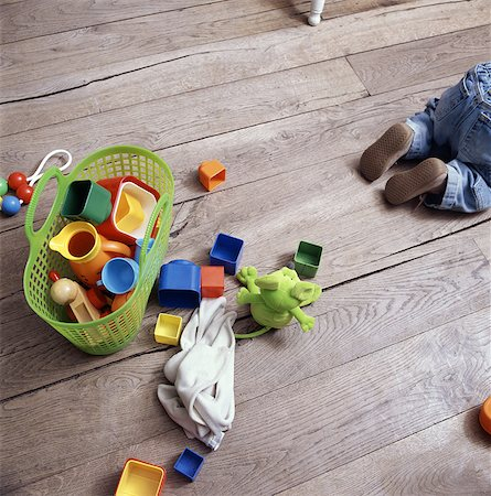 Babys toys on wooden floor Stock Photo - Premium Royalty-Free, Code: 649-05820058