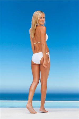 sexi women full body - Woman wearing bikini by infinity pool Stock Photo - Premium Royalty-Free, Code: 649-05820091