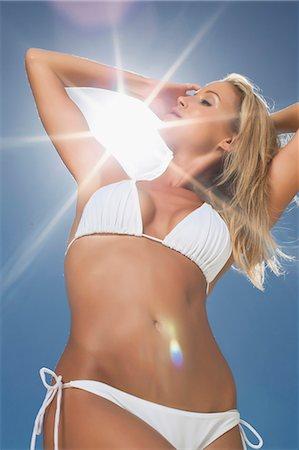 Woman wearing bikini outdoors Stock Photo - Premium Royalty-Free, Code: 649-05820154