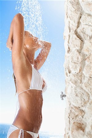 shower - Woman rinsing off in outdoor shower Stock Photo - Premium Royalty-Free, Code: 649-05820167