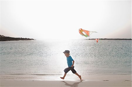 Boy flying kite on beach Stock Photo - Premium Royalty-Free, Code: 649-05820298