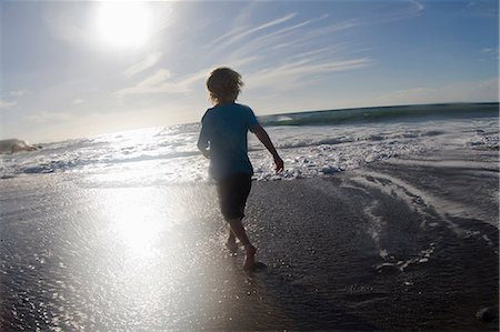 discovery - Boy playing in waves on beach Stock Photo - Premium Royalty-Free, Code: 649-05820290