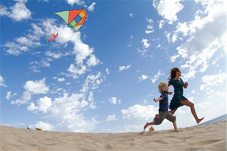 family active beach - Mother and son flying kite on beach Stock Photo - Premium Royalty-Free, Code: 649-05820293