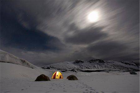 Illuminated tent at glacier campsite Stock Photo - Premium Royalty-Free, Code: 649-05820425
