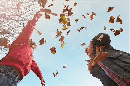Children playing with autumn leaves Stock Photo - Premium Royalty-Free, Code: 649-05820449