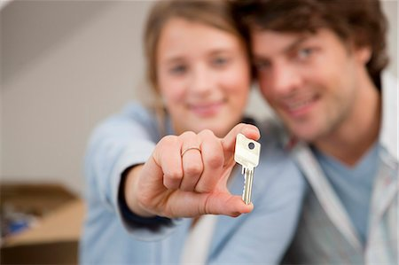 Woman holding key to new home Stock Photo - Premium Royalty-Free, Code: 649-05820543
