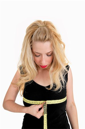 Woman measuring her bust Stock Photo - Premium Royalty-Free, Code: 649-05820628