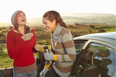 remote car - Women drinking coffee from thermos Stock Photo - Premium Royalty-Free, Code: 649-05820897