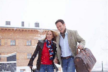 Couple walking together in snow Stock Photo - Premium Royalty-Free, Code: 649-05821088