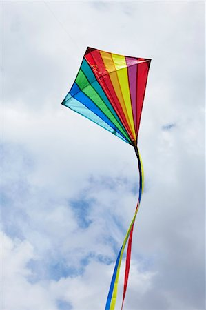 Kite flying in cloudy sky Stock Photo - Premium Royalty-Free, Code: 649-05821184