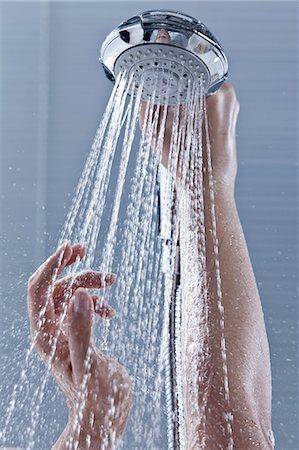 Hands holding shower head Stock Photo - Premium Royalty-Free, Code: 649-05821397