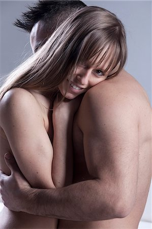 Smiling nude couple hugging Stock Photo - Premium Royalty-Free, Code: 649-05821547