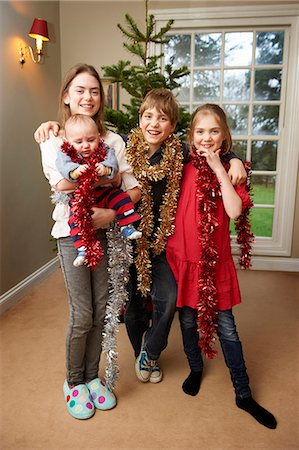 Children playing with Christmas tinsel Stock Photo - Premium Royalty-Free, Code: 649-05949507