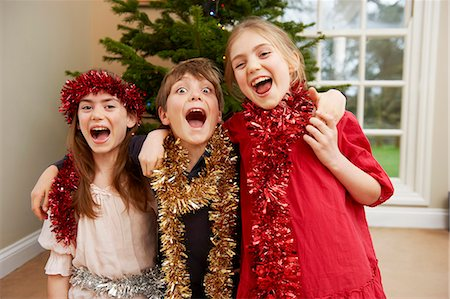 preteen open mouth - Children playing with Christmas tinsel Stock Photo - Premium Royalty-Free, Code: 649-05949508