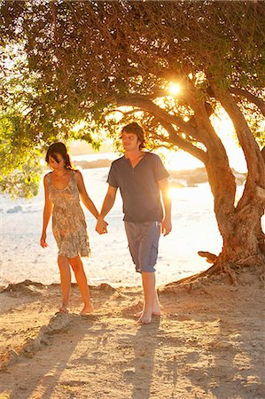 Couple walking barefoot in park Stock Photo - Premium Royalty-Free, Code: 649-05949591