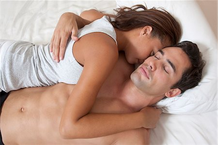 Couple sleeping in bed together Stock Photo - Premium Royalty-Free, Code: 649-05949629