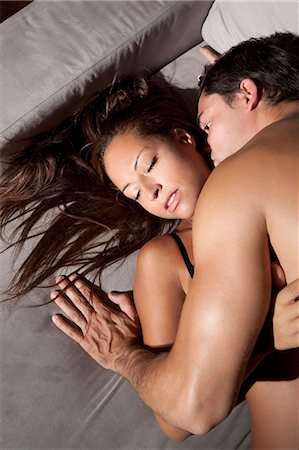 Couple kissing on sofa Stock Photo - Premium Royalty-Free, Code: 649-05949652