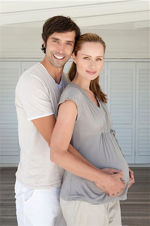 portrait of pregnant woman - Man holding pregnant girlfriends belly Stock Photo - Premium Royalty-Free, Code: 649-05949740