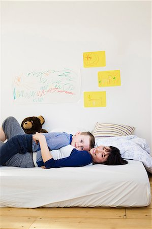 Mother and son relaxing on bed Stock Photo - Premium Royalty-Free, Code: 649-05949788