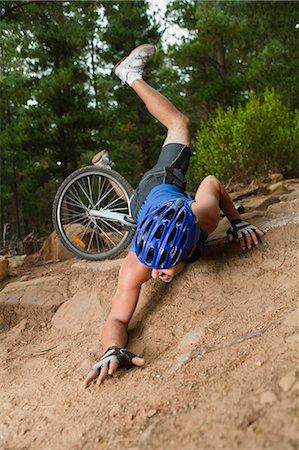 dangerous accident - Man falling off mountain bike Stock Photo - Premium Royalty-Free, Code: 649-05949860