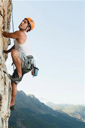 rock climber - Climber scaling steep rock face Stock Photo - Premium Royalty-Free, Code: 649-05949892