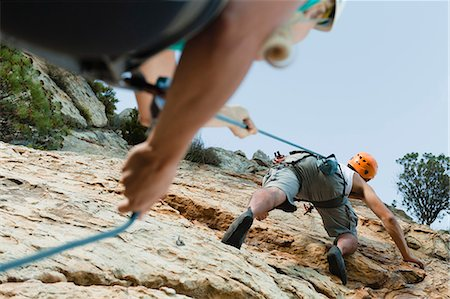 Climbers scaling steep rock face Stock Photo - Premium Royalty-Free, Code: 649-05949893